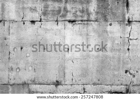 Cracks in grey concrete wall - stock photo