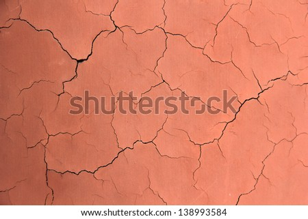 cracks in red wall in a park, north china - stock photo