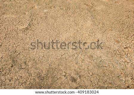 Cracks in the dried soil in arid season - stock photo