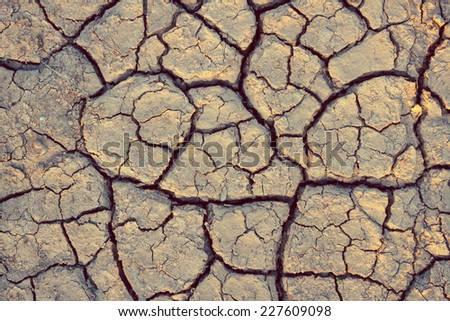 cracks in the ground background - stock photo