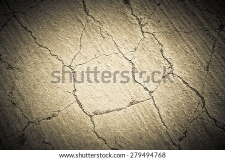 Cracks on the sand. Natural background. Toned. - stock photo