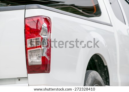 Cracks white car from being bumped the rear lights. - stock photo