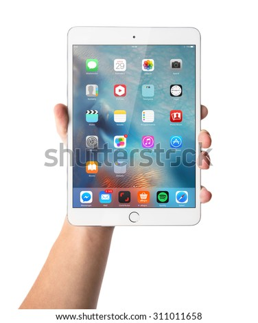 CRACOW - August 28: Man hand holding the iPad mini 3 retina isolated on white background, Poland on august 28, 2015. - stock photo