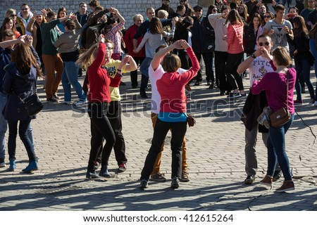 CRACOW, POLAND - APRIL 2, 2016: International Flashmob Day of Rueda de Casino, 57 countries, 160 cities. Several hundred persons dance Hispanic rhythms on the Main Square in Cracow. Poland - stock photo