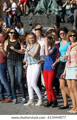 CRACOW, POLAND - APRIL 1, 2017: International Flashmob Day of Rueda de Casino, 57 countries, 160 cities. Several hundred persons dance Hispanic rhythms on the Main Square in Cracow. Poland