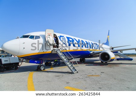 CRACOW, POLAND - CIRCA JANUARY 2015: Ryanair Jet aircraft preparing for boarding. Ryanair is the biggest low-cost airline company in the world. - stock photo