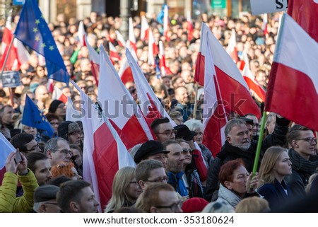 CRACOW, POLAND - DECEMBER 19, 2015: Cracow, Main Square -  The demonstration of the Committee of the  Protection of the Democracy / KOD/ against the break of law through the government PIS in Poland.