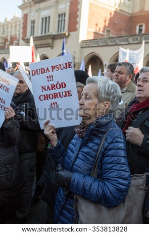 CRACOW, POLAND - DECEMBER 19, 2015: Cracow, Main Square - The demonstration of the Committee of the Protection of Democracy / KOD/ against the break of law through the government PIS in Poland.