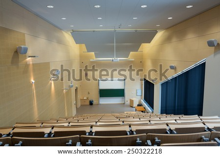 CRACOW, POLAND - JANUARY 29, 2015: Cracow - Jagiellonian Univesity . Faculty of Physics, Astronomy .Interior of modern lecture room - stock photo
