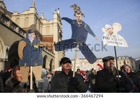 CRACOW, POLAND - JANUARY 23, 2016: Demonstration against governmental surveillance on Internet organized by The Committee for the Defence of Democracy / KOD / at the Main Square in Cracow, Poland - stock photo