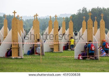 CRACOW, POLAND -  JULY 26, 2016: Pilgrims in Zone of Reconciliation at Sanctuary of Divine Mercy in Lagiewniki. WYD participants will be able to confess to more than 50 confessionals. Cracow Poland