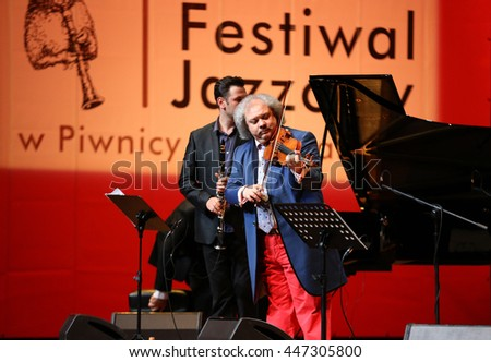 CRACOW, POLAND - JUNE 11, 2016: Roby Lakatos  Romani violinist from Hungary  playing live music at Summer Jazz Festival in Cracow, Poland