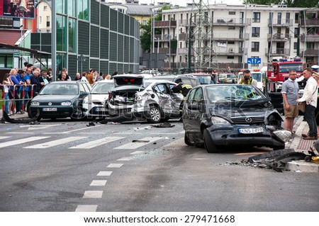 CRACOW, POLAND - MAY 19, 2015: Car accident when a truck ran between two rows of cars waiting at red light at the crossroads. 19 cars were damaged, 15 people were injured.  - stock photo