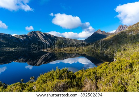 Cradle Mountain on clear day reflected in Dove Lake. Cradle Mountain - Lake St Clair National Park, Tasmania, Australia - stock photo