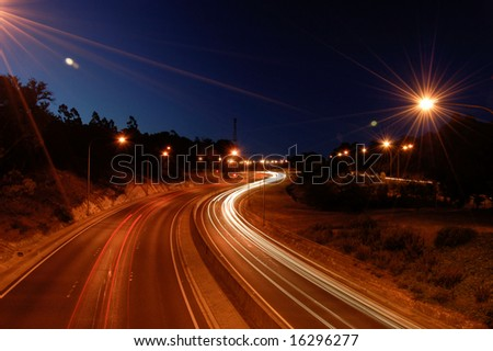 Crafers freeway at night with traffic blur showing motion of cars