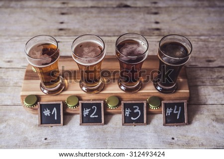 Craft Beer Tasting (Wood Background) - stock photo