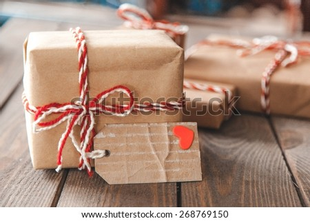 Craft. Handmade present boxes with tags and twine cord ribbons - stock photo