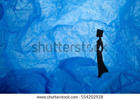 Craft paper background with silhouette of a woman