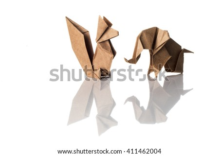 Craft paper origami elephant and squirrel isolated on white background. - stock photo