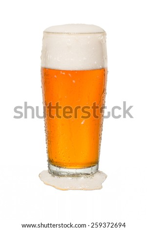 Craft Pub Beer Glass with Beer Spilt - stock photo