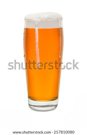 Craft Pub Glass with Beer and Foam Running Down Side of Glass #3 - stock photo