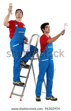 craftsman and apprentice painting - stock photo