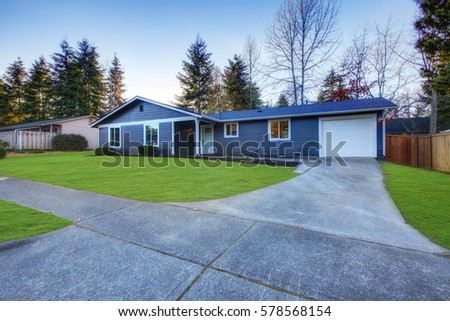 Craftsman Blue One Story Low Pitched Roof Home In Tacoma. Well Kept Front