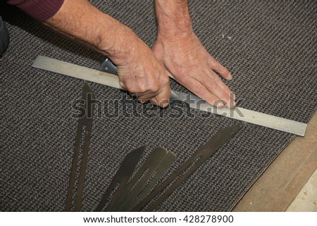 Craftsman carpeting a staircase with vintage tools