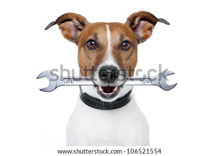 craftsman dog with a wrench - stock photo