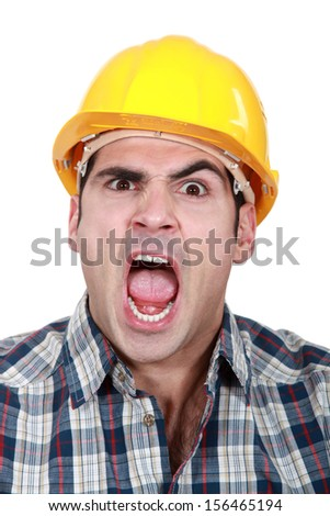 Craftsman having fit of anger - stock photo