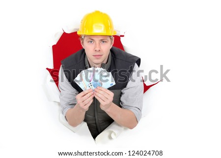craftsman holding money - stock photo