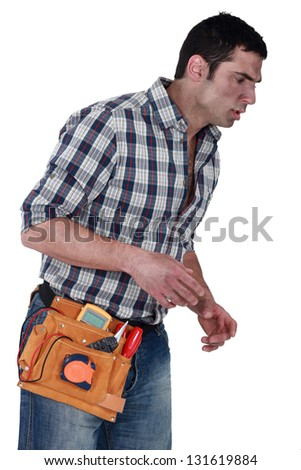 craftsman looking exhausted - stock photo