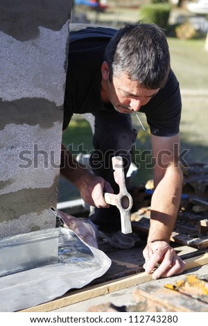 craftsman nailing - stock photo