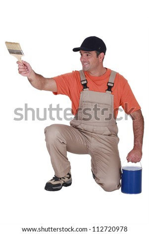 craftsman painter holding a brush and a can - stock photo