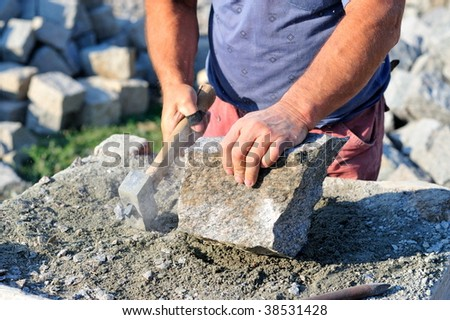 craftsman shaping stone