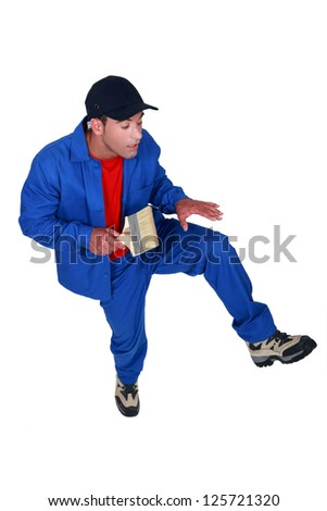 craftsman walking with caution - stock photo