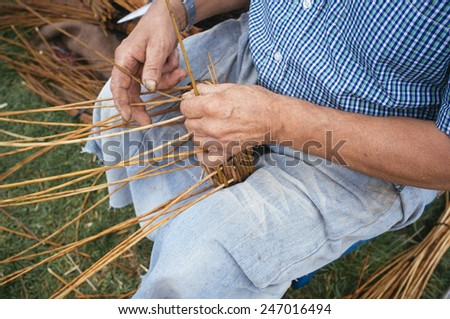 craftsman weaving a wicker basket