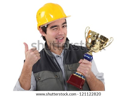 Craftsman winking holding trophy - stock photo