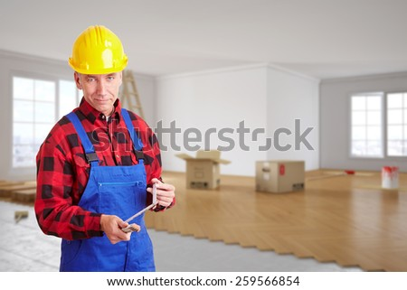 Craftsman with folding rule standing in a room during renovation (3D Rendering of background) - stock photo