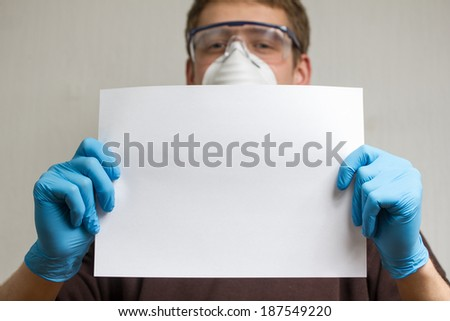 craftsman with plain paper sheet - stock photo