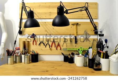 craftsman workshop homemade wooden workbench with tools - stock photo