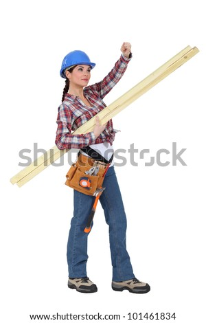 craftswoman carrying wooden boards - stock photo
