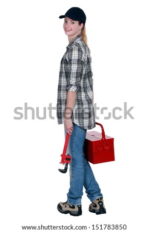 craftswoman holding a tool box and a spanner - stock photo