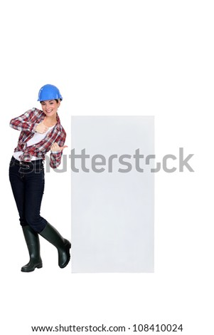 craftswoman pointing at copyspace - stock photo