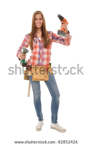 Craftswoman with the tool belt and two screwdrivers in his hand - stock photo
