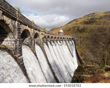 Craig Goch dam overflowing with water in the Elan Valley Wales UK.