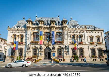 Craiova, Romania - September 16, 2016: People are passing by  Craiova City Hall, Romania