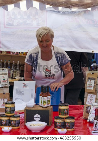 CRAMLINGTON. NORTHUMBERLAND. UK. JULY 30. 2016. Stall holders and their goods display foodstuff and goods at the Annual Food Festival. July 30. 2016, Cramlington, Northumberland, England, UK.