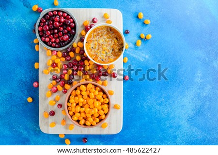 Cranberries and sea buckthorn mix. Top view Copy space
