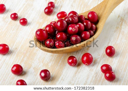Cranberries in a  wooden spoon. Selective focus - stock photo